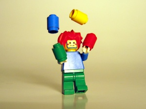 lego figure juggling blocks